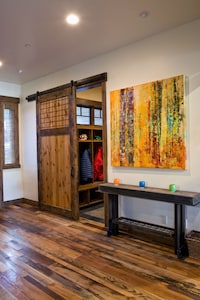 Entry with barn door into mud room and garage w/ boot and glove heater