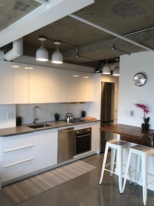 Newly renovated modern kitchen with Bosch stainless steel appliances throughout.