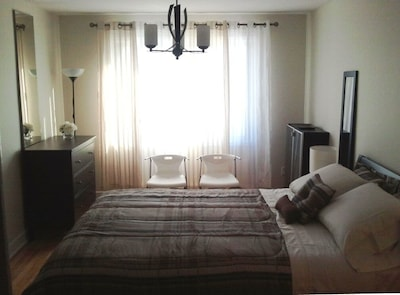 Bedroom #1. Tranquil and serene. Queen size bed and offers a walk-in closet.