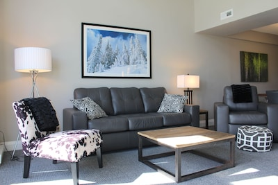 Come relax in the living room with sofa bed and over sized comfy furniture.
