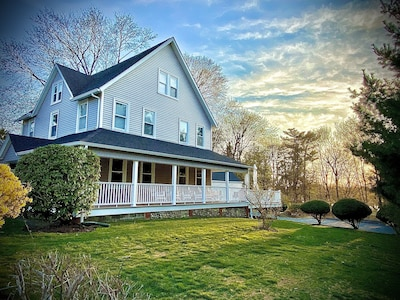 Over a half acre of privacy, a wrap-around covered porch, and large open deck