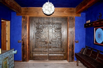 Entrance foyer area. Large custom carved doors