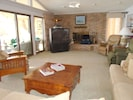 Great room opens to screened porch