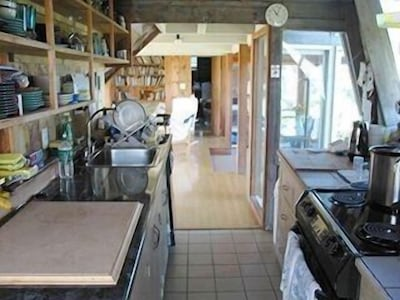 Fully equipped kitchen with plenty of light and a great water view.