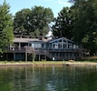view of house from Lake.  Upper deck on left is same area as the sunset picture,