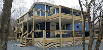 New huge deck, windows, siding, and doors! Same great house, all new look!