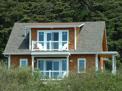 The Sunset Beach Carriage House viewed from the beach.