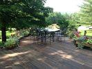 Large deck with view to tennis court and lower field... pond just beyond