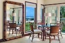 Dining area with ocean view from Waipouli Beach Resort Condo with Fine Art