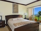 King size bed in bedroom with ocean view at from Waipouli Beach Resort Condo