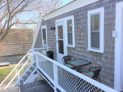 This studio unit has a private deck with table & chairs with great sunset views.