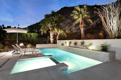 Pool, patio, fire feature and natural landscape southern view.