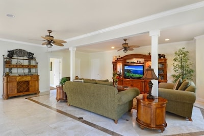 Family Room with large entertainment center and 50' TV