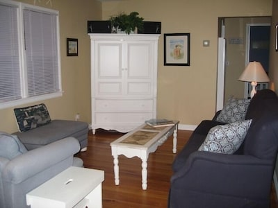 Living Room with flat screen TV in armoire