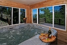 Enclosed hot tub. Room is not heated. Can open windows and slider to deck.