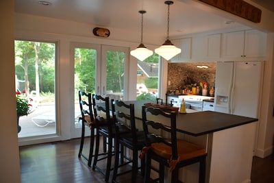Large open kitchen. Chefs have 360 view of living room, dinning room and pool