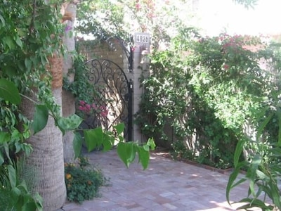 Private front entry with custom wrought iron gate & off-street parking