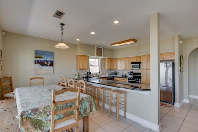 Large dinning room open to kitchen with additional seating around kitchen bar.