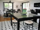 Slate kitchen island & granite dining room table. Seating for 10.