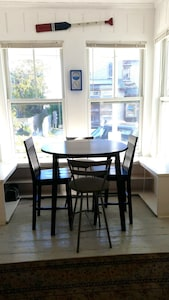 The dinning table has views of the water and of Commercial Street.