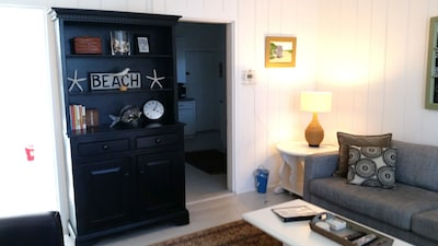 This beautifully  decorated, spacious 2 BR, 2 bath unit has a combined LR/Dining