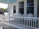 Private porch, plenty of seating. Enjoy am coffee & PM cocktails & people watch.