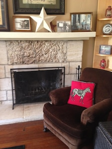 Nestle next to the fireplace. The living room overlooks a hill country meadow.