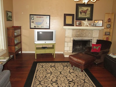 Our spacious and elegant living room has books, games and cable TV.