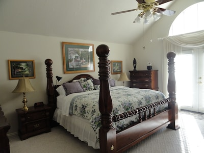 Master  Bedroom Downstairs - Spacious & inviting  w/ French Doors to the pool