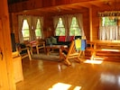 Prong Mountain Cabin - Open living/dining area overlooking front porch.