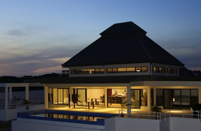 Infinity pool and outdoor space at sunset