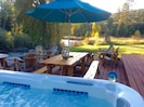 Jacuzzi on our deck with a custom log dining table and adirondeck chairs too!