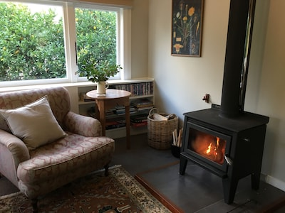 Lounge with cozy woodburner