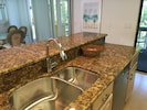 Kitchen with breakfast bar, new appliances and granite countertops