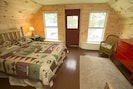 Lake House master bedroom with queen sized Adirondack bed and water view.