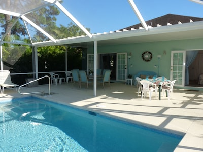 Sunny, Saltwater, solar heated pool with large screened LANAI No harsh chemicals