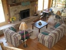 Large, wood-burning fireplace & comfy couches