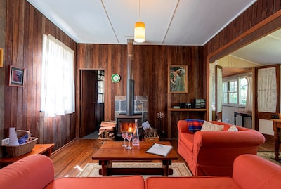 Living room for four, with cosy wood fire