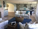 Front living room/kitchen and wet bar with sink. Island has 4 stools.