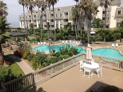 This is taken of the pool area from the end of the hallway of our unit