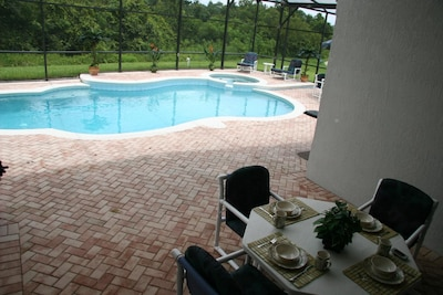 Enjoy your meals under the Lanai. Over head Fan (shown without fence)