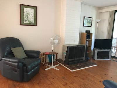 Living room with cozy gas fire in addition to ducted heating.