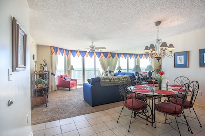 View of the dinning and living room and the ocean.