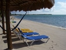 A lounger awaits on your private manicured beach