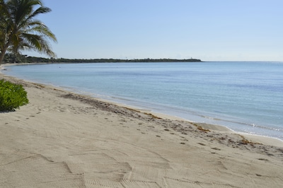 A calm morning on your private beach on Soliman Bay