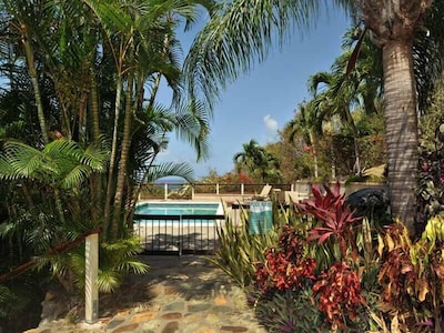 Beautiful pool, expansive deck just steps from this fully renovated 1BR Condo