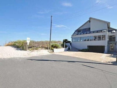 FRONT OF HOME AND ENTRANCE TO BEACH