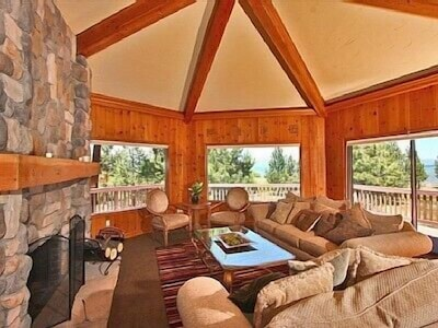 """""""Alaska Room"""" with large wood burning fireplace and awesome lake and mnt. views"""