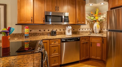 This kitchen is fully equipped with pots, pans and Breakfast Bar.
