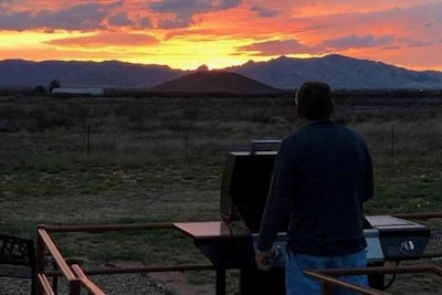 Grill in a sunset at Hummingbird Ranch with 3 decks to relax enjoy at our Ranch.